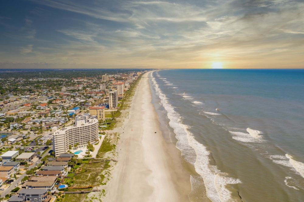 Aerial view of Jacksonville beach on a sunset